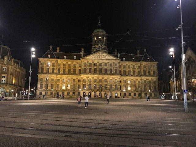 Dam square by night - overnight layover Amsterdam