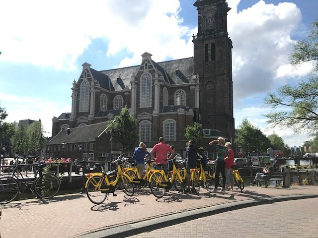 Tourists on yellow bikes - Bikes Amsterdam
